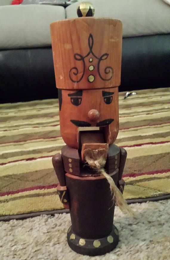 A fine Nutcracker Man with much attention to detail, down to the Beard on his chin. He is made of Wood and measures approximately 11 x 3 1/2 x 6. He wears his Crown well and is in Great condition. He receives the nut in his mouth and cracks it as you close his mouth.  Find more vintage @ http://www.shortiesvintagetreasures.com *** http://www.shantonbooks.com http://www.vintagepearls.ecrater.com  ** IF YOU ARRIVED HERE FROM Etsy Marketplace, Please Visit our ...