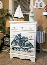 This awesome dresser is in great condition, drawers slide smoothly... rope handles have been added to make it really feel nautical! Dresser was chalk painted & the sailboat was hand drawn & painted. All has been wax finished to give it a really nice finish.