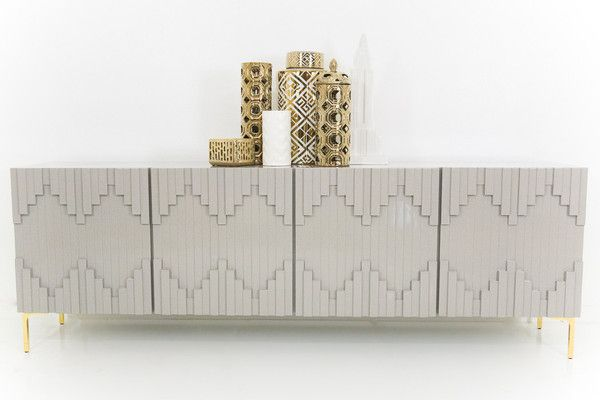 Mimicking the the city skyline with it's straight lines, the Manhattan Credenza is inspired by it's namesake. With hints of art deco in Greystone, and brass legs it's a perfect addition to your collec
