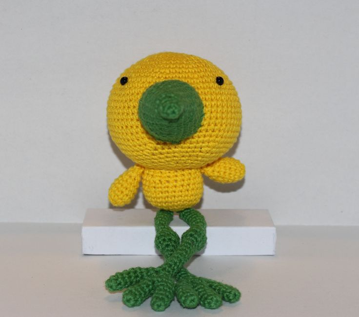 Wanted: A home for this cute little bird with knobby knees and a head that is slightly too big for his body.  It will arrive wearing a gift tag with a little message and nicely wrapped.  The bird is also available in a light green & pink version and a purple and orange version.