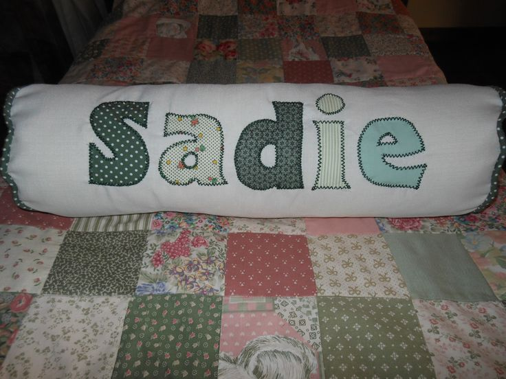 Another bolster cushion with a child's name, in vintage greens.