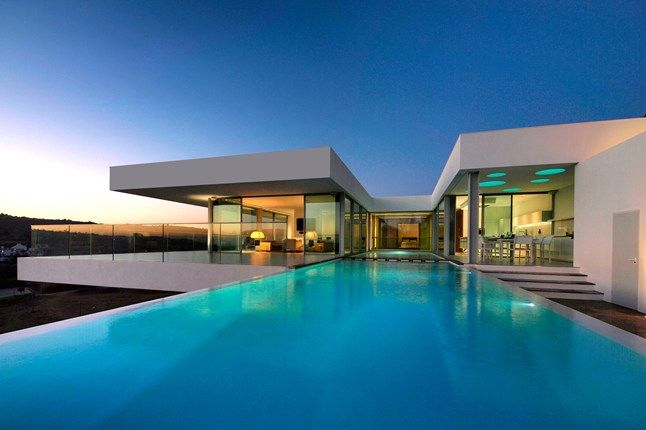 According to Condé Nast Traveller UK two of The best swimming pools in the world are located in Portugal (2013): The decanter-shaped pool of The Yeatman wine hotel, in the historic Vila Nova de Gaia district of Porto and  The cantilevered swimming pool at contemporary Villa Vidro, near Praia da Luz in the Algarve, Portugal.