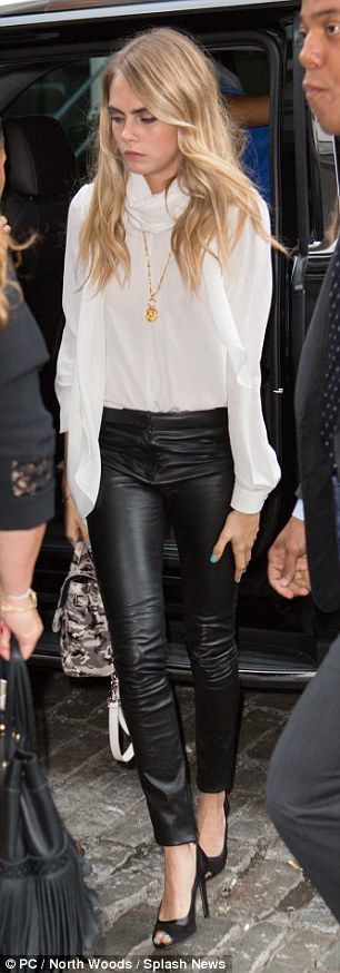 Model figure: Cara showed off her long legs in a pair of leather trousers on Monday...
