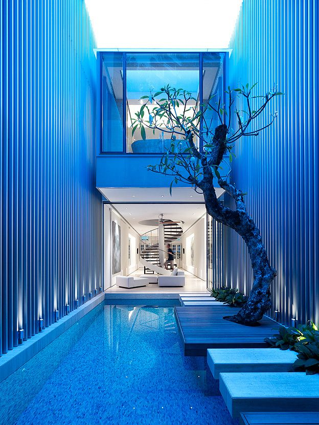 For all the cold, hard lines that contemporary design creates, the use of shallow water pools really bring an elemental energy to dwellings and blur the line between indoor/outdoor spaces