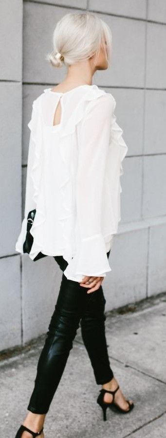 White Ruffle Blouse + Black Leather Pants                                                                             Source