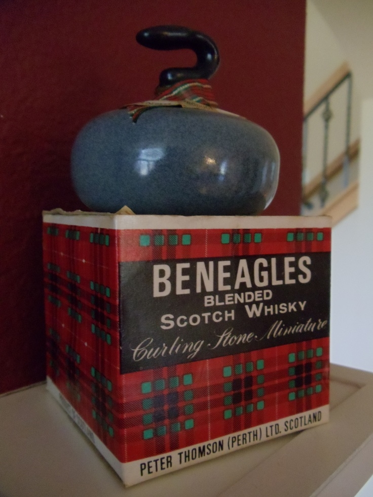 great older Scotch whisky curling stone decanter