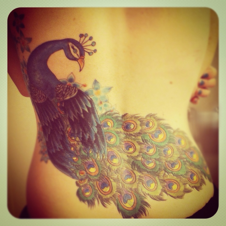 I know I already have a peacock tattoo but I still want another one. This would be pretty sweet to have!