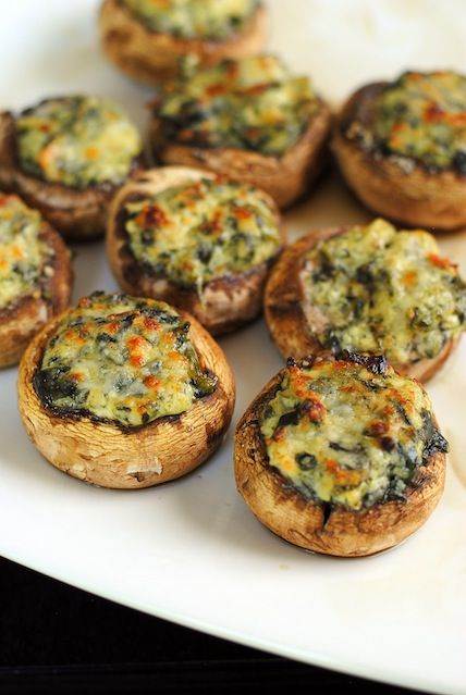 Spinach Artichoke Stuffed Mushrooms-use premade dip and sprinkle with Parmesan.