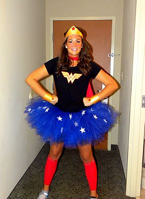 A wore a plain black tee with a handmade Wonder Woman logo that was traced and cut out of adhesive felt. Make the tutu using blue tulle and added some Styrofoam white stars. Wear red shin sleeves to look a little like her boots. I also made a superhero cape from a bargain tee by cutting it up. Finally I paired it with cuffs and a crown I made from gold styrofoam and some elastic.