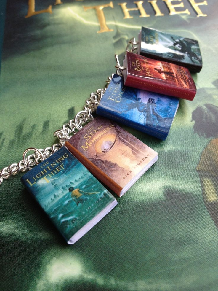 Percy Jackson and the Olympians Book Bracelet. $19.00, via Etsy.(At first I thought the regular sized Lightning Thief was a giant poster,oops.)