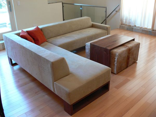 Custom Beam Sectional with custom walnut + cowhide ottoman for a NYC  apartment on the Upper East Side. Coffee