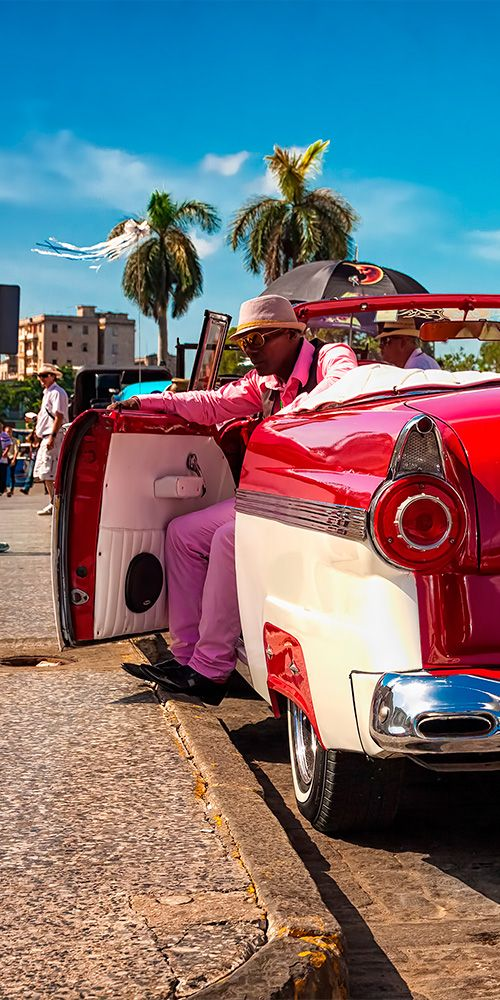 Remnants of the 1950s, Havana's streets are packed with vibrant vintage cars Photo - Kamira #Havana