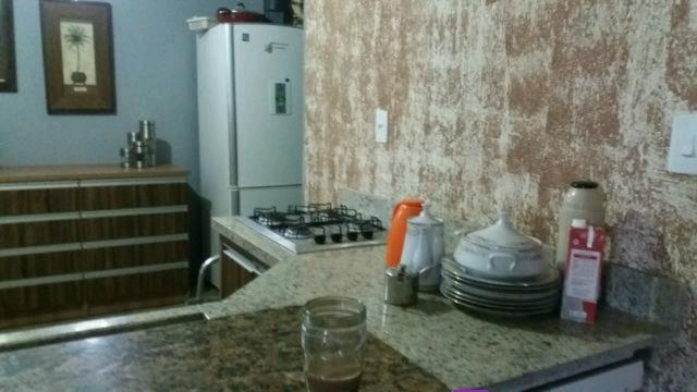 Casa no Balneário Arroio do Silva, por terreno em Araranguá