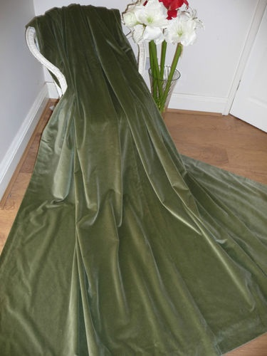 Velvet might be a bit heavy, but it's good to have a variety of textures in a room.  These vintage-style sage green velvet curtains are fab!