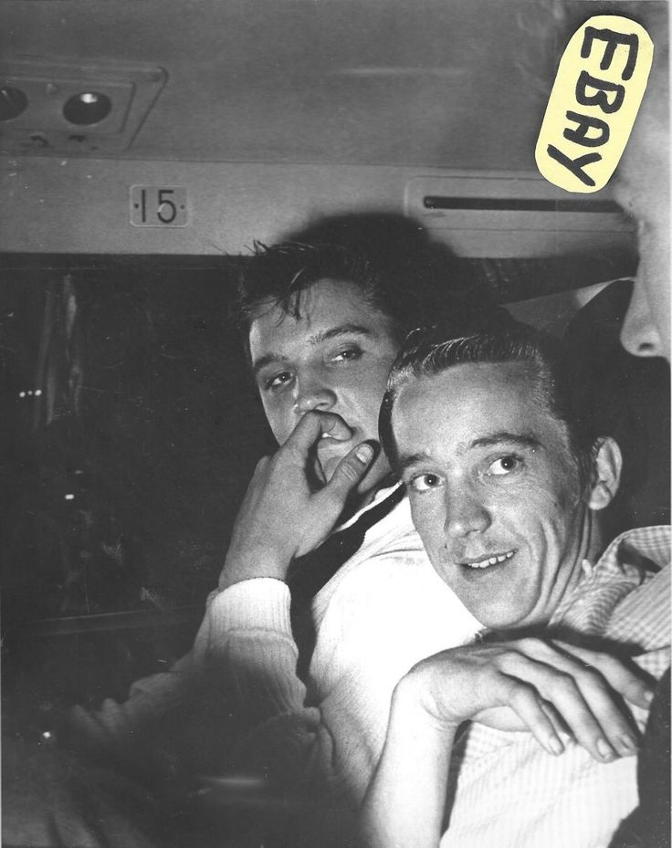 "Elvis Presley, his cousin Gene Smith and actor Nick Adams are pictured on an American Airlines plane bound for Memphis, TN on Saturday, September 22, 1956. The three took a very late flight out of Los Angeles, CA where Elvis had been working on his first movie ""The Reno Brothers"" for 20th Century Fox. (Filmed from August 23 until October 8, 1956 and later renamed ""Love Me Tender"".) On the flight home Elvis used the name ""Clint Reno"" which was his character's name in the movie."