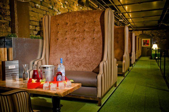 Vin de Syrah has outrageous decor, a door made of grass, and amazing haopy hou