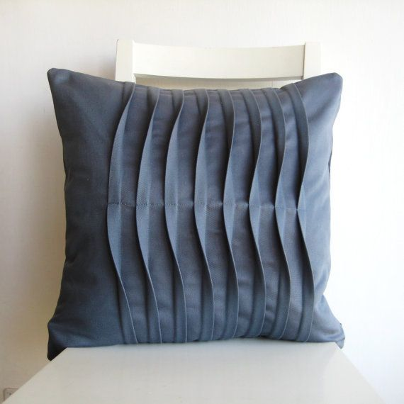 This handmade throw pillows is sewn with grey cotton - drill. Decorated with pleats. Double stitched for re-inforcement. Inside edges are lock stitched
