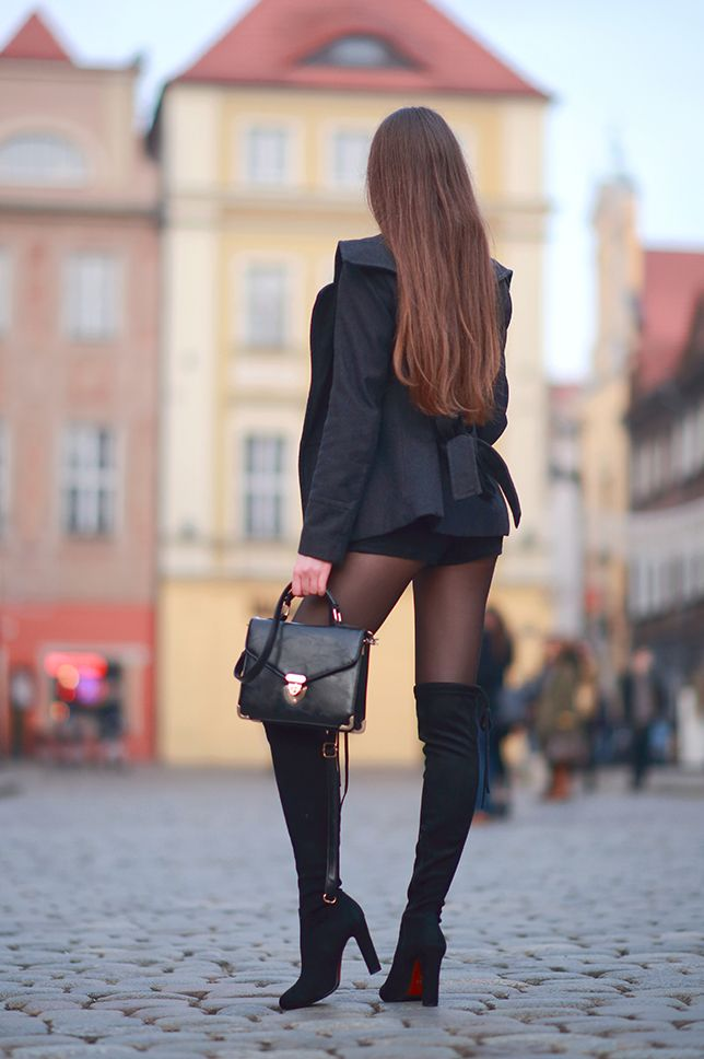 7388f2e84a6 girl wearing black thigh high boots on black pantyhose with black shorts