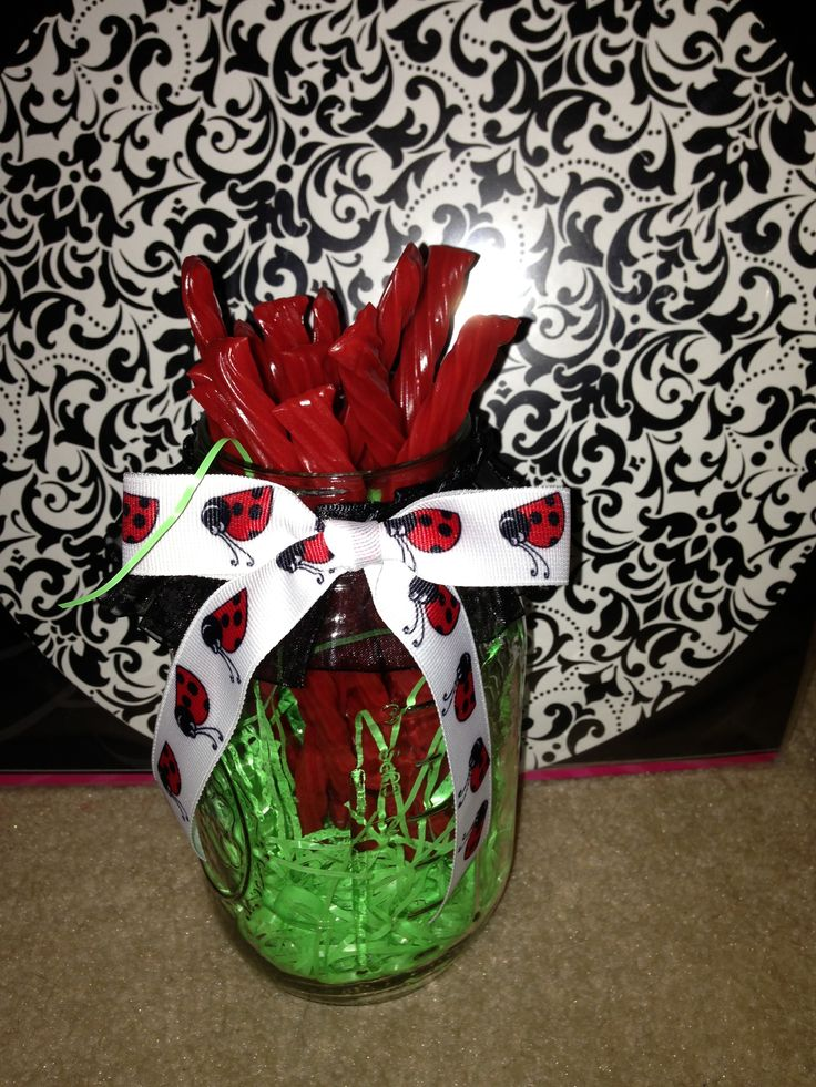 Twizzler-filled mason jars with ladybug ribbon - delicious centerpieces!