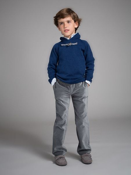 Blue Steel Winter Days Outfit Boys' classic pullover in navy with contrast grey intarsia elbow patches and steel grey velvet frog closure Designed by: Fina Ejerique Made in Spain