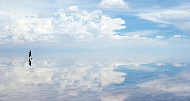 World's largest salt flat is located in Salar de'Uyuni, Bolivia. During the rainy season, the water turns it into the world's largest mirror. The reflection of the sky creates a sense of infinity, like you're walking among the clouds. It's called the border between heaven and earth.