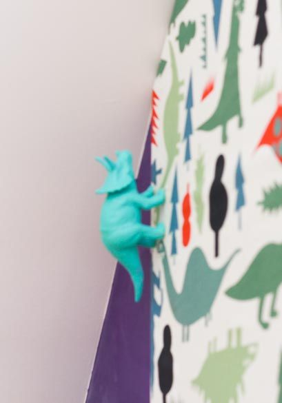 Dinosaur door handles to match cute dino fabric on cupboard doors.