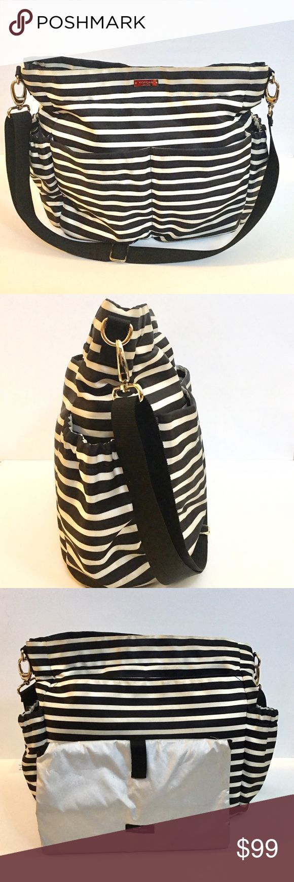 Kate Spade Holland Walk Diaper Bag Nylon black and white stripe Kate Spade diaper bag with full size changing pad that doubles as a diaper clutch.  Stroller loops on bag and messenger style carry. 4 exterior pockets and 3 interior. Some wear and tear on white portions of the bag. Magnetic closure. kate spade Bags Crossbody Bags