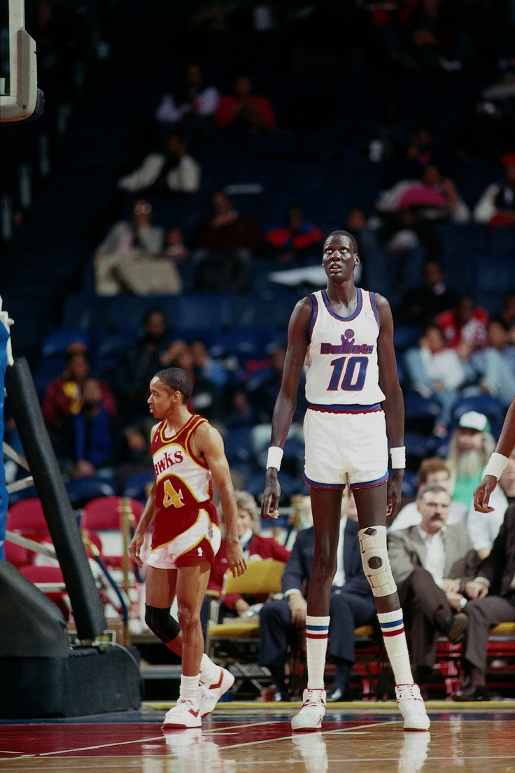 "The ""long"" and ""short"" of it...Manute Bol (7' 7"") and Spuds Webb (5' 7"")"