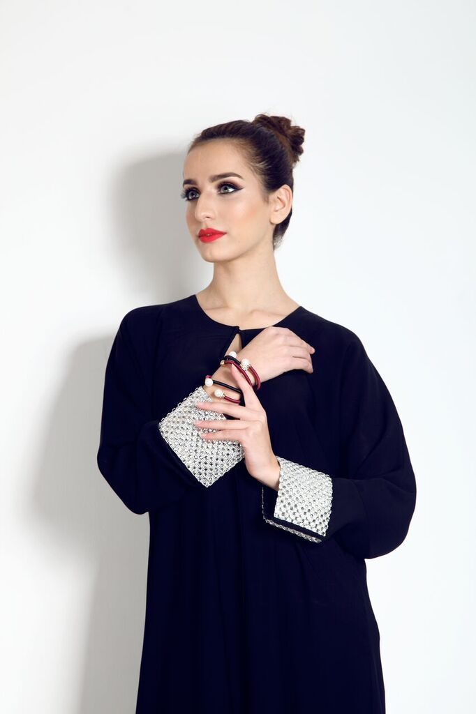 Our beautiful Abaya with clear geometric crystal work sleeves with lace end, is yours, from our website, for only £80