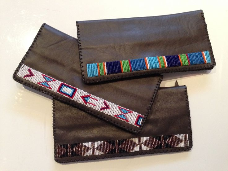 Stunning handmade leather wallets, from Kenya. Made with beautifully soft leather and pure glass. Such a lovely gift or treat for yourself! http://www.uberpolo.com/handbags-1/