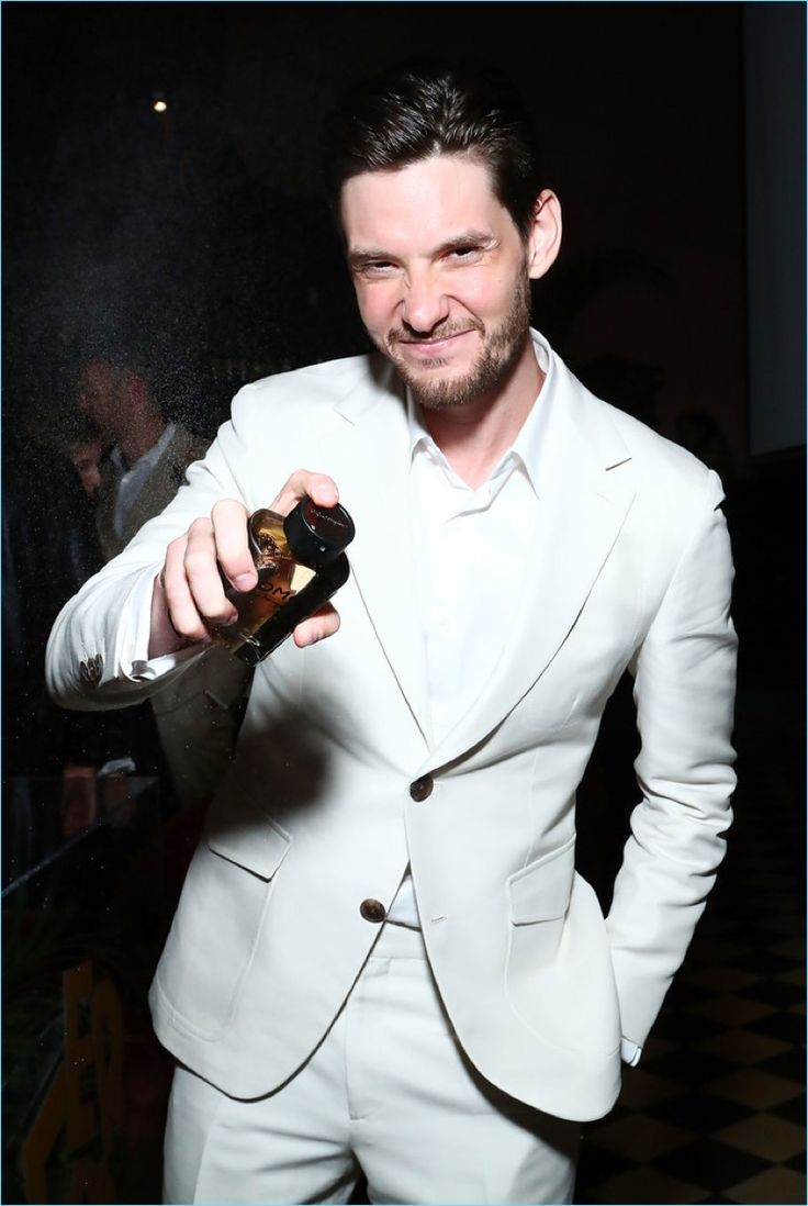 Hosting an event for Salvatore Ferragamo Uomo Casual Life in New York, Ben Barnes sprays a splash of the new fragrance.