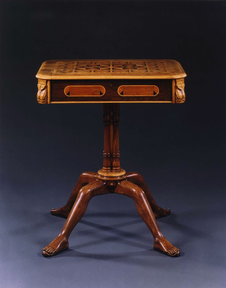 AN AMUSING MAHOGANY CENTER TABLE INLAID WITH SPECIMEN WOODS.  English. Second Quarter Of The Nineteenth Century.