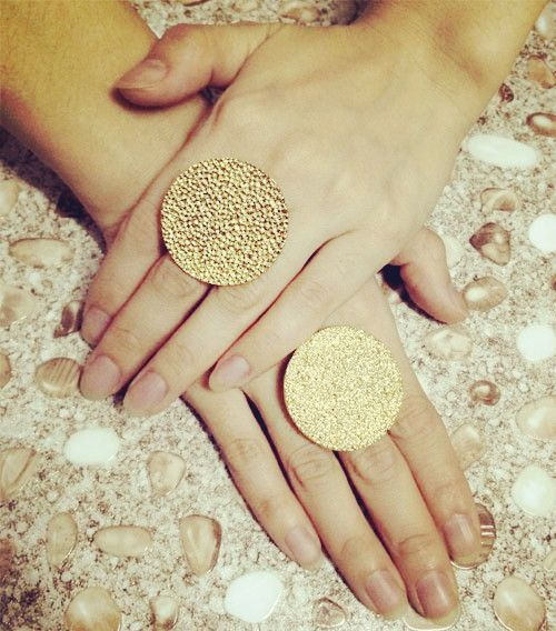 The gold disc ring is made from metal alloy, the light weight ring makes a powerful statement.Pair it with a long grey cape and a black skater skirt for a chic look. Found on explorate.in