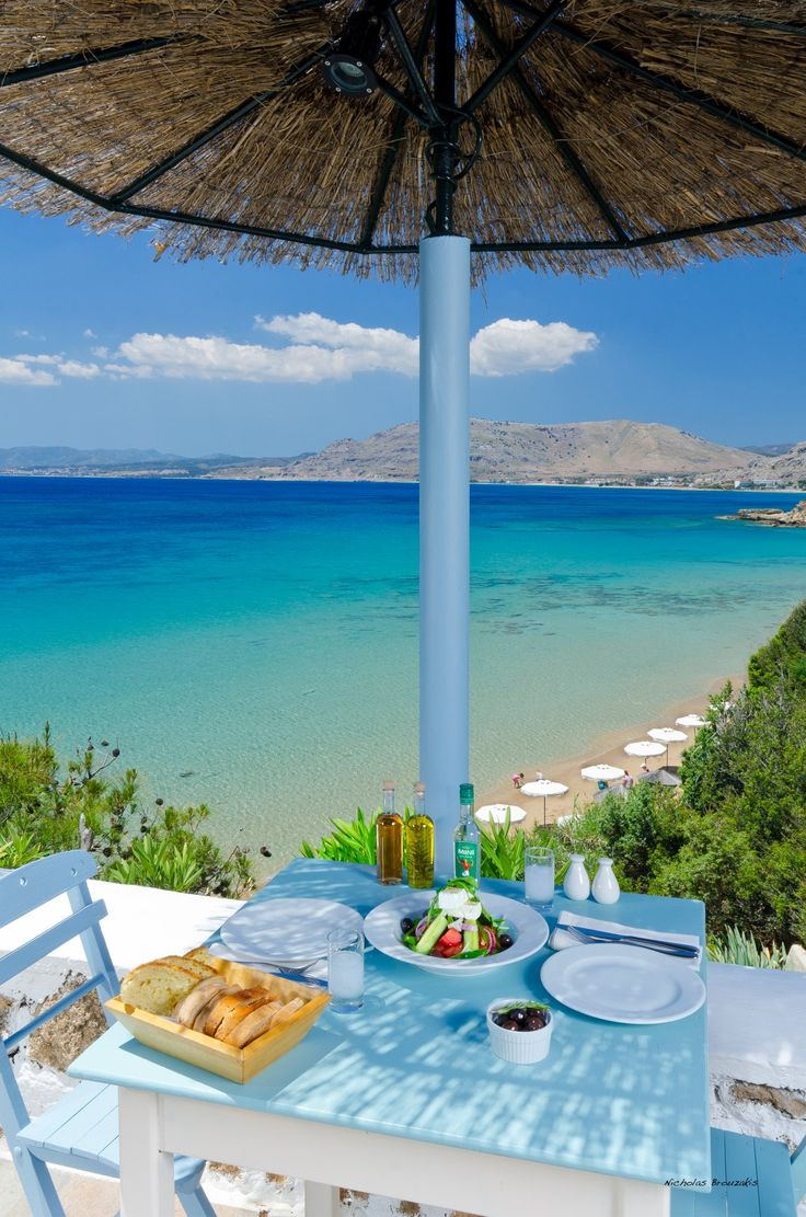 Rhodes, Greece ..Greek salad & bread on the table too but where's the Ouzo…