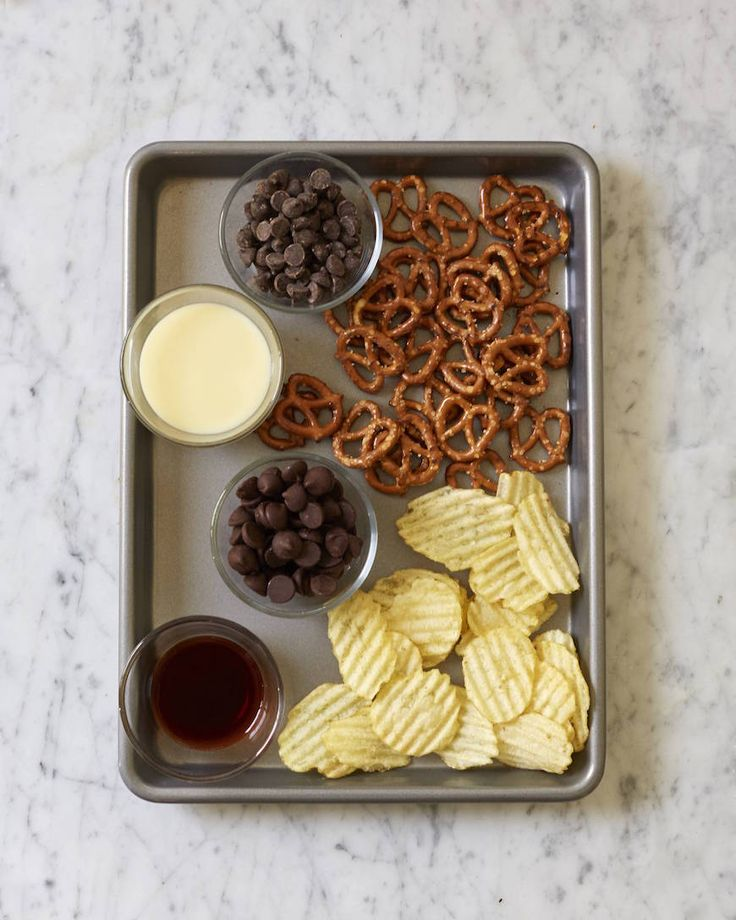 "Potato Chip & Pretzel Fudge::3cups semisweet chocolate chips •1 14oz can sweet condensed milk • 2t vanilla extract •6oz melted dark chocolate •1c Wavy potato chips, crushed •1c mini pretzels, crushed. Line square 8"" bake pan w/parchment. Over low heat, in medium pot, add chocolate chips/salt/ condensed milk. Stir w/wooden spoon til chips are melted and mix is smooth. Remove from heat. Add vanilla - stir in ½c each - crushed pretzels + chips."