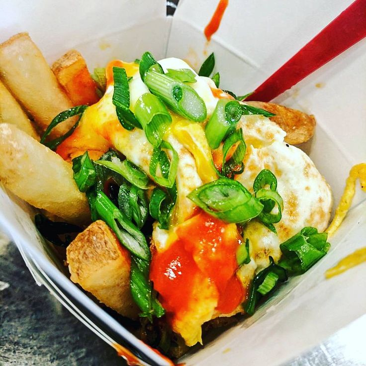 The Bay State Poutine: French Fries, Demi Glace, Fried Egg, Sriracha & Scallions