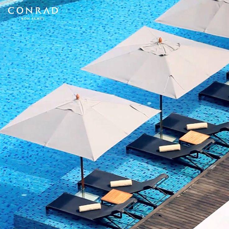 Poolside lounging at Conrad Koh Samui.