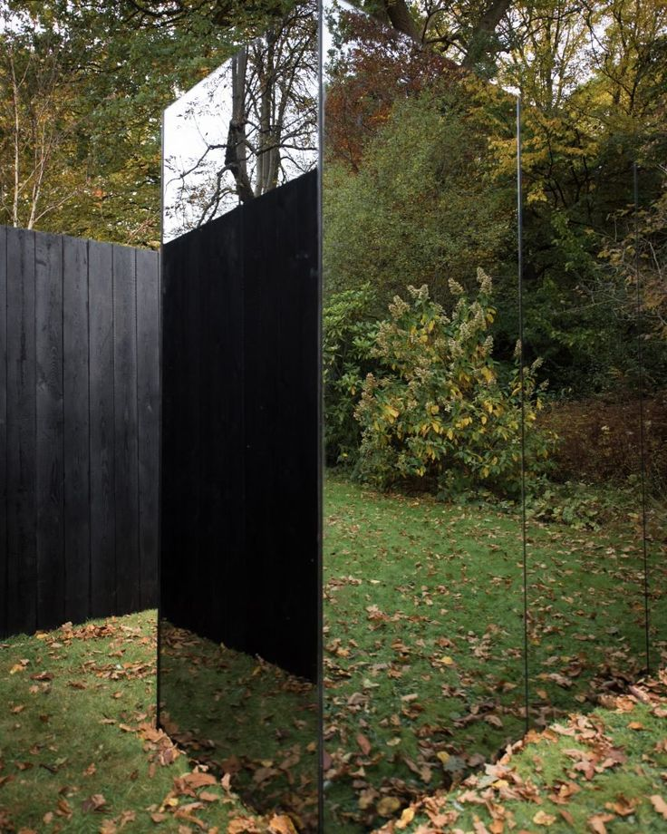 """""""The reflections of the smoked mirrored exterior allow the installation to embed itself within its context,"""" says architect Scott Kyson"""