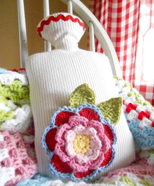 Make a new hot water bottle cover out of an old sweater and jazz up with a gorgeous crochet corsage.