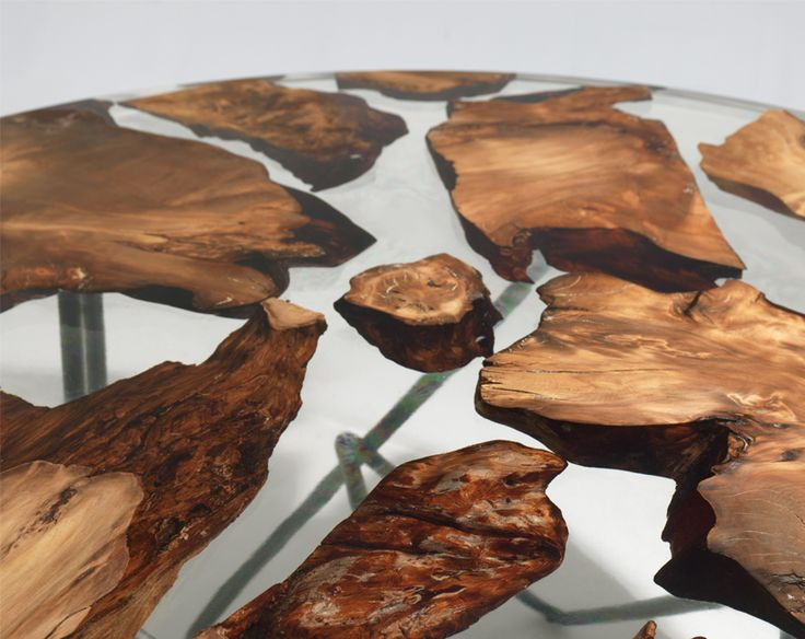 imm cologne 2017: riva 1920 earth table floats 50,000 year old wood in resin