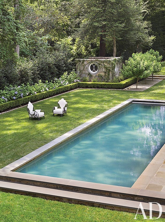 Traditional Pool by Suzanne Kasler Interiors and William T. Baker & Associates Ltd. in Atlanta, Georgia