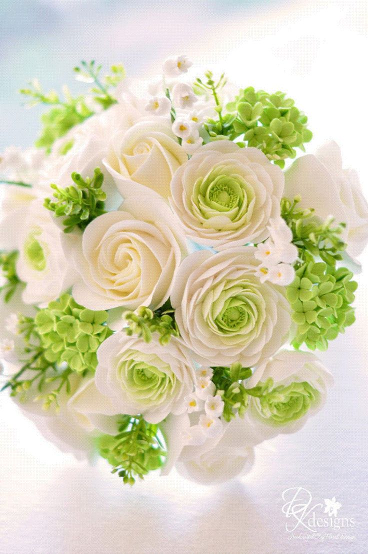 A beautiful clay flower arrangement of Ranunculas, Roses and Hydrangeas by DK Designs