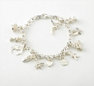 Create Your Own Story Charm Bracelet  Item 110583724    Creating a charm bracelet to tell a very personal story is easy... because we will do all the work for you. You just need to do the fun bits!
