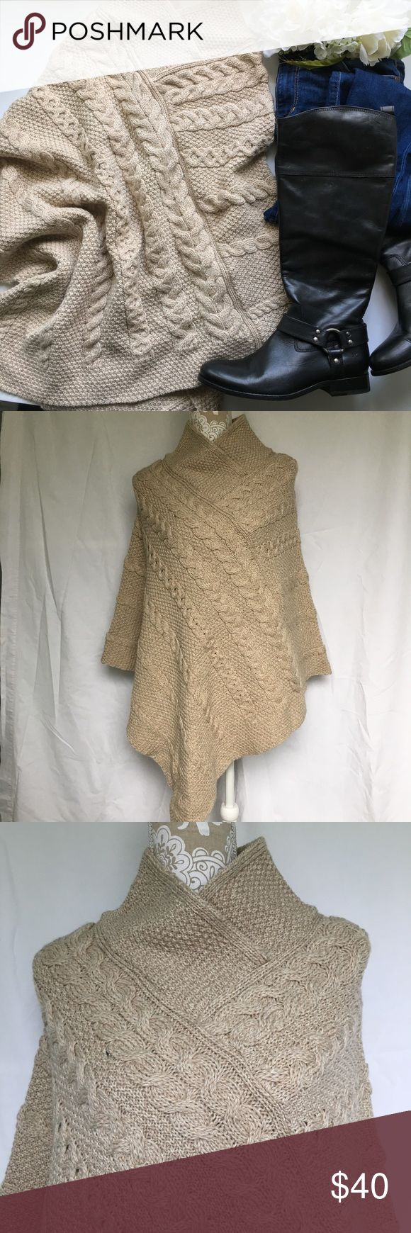 Inis Crafts // Merino Wool Cable Knit Cape - tan Extra comfy cape for the colder months. Purchased from TJ Max, brand is Inis Crafts. 100% merino wool. Cable knit design. Mock turtleneck collar. Tan color. V shape front and back. In excellent condition, never been worn. Inis Crafts Sweaters Shrugs & Ponchos