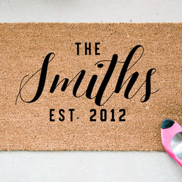 Help your in-laws warmly welcome their guests with this personalized doormat that's super stylish. | Holiday Gifts for In-Laws - Personalized Calligraphy Door Mat