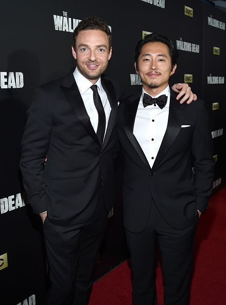 Ross Marquand and Steven Yeun attend AMC's 'The Walking Dead' Season 6 Fan Premiere Event 2015 at Madison Square Garden on October 9 2015 in New York...