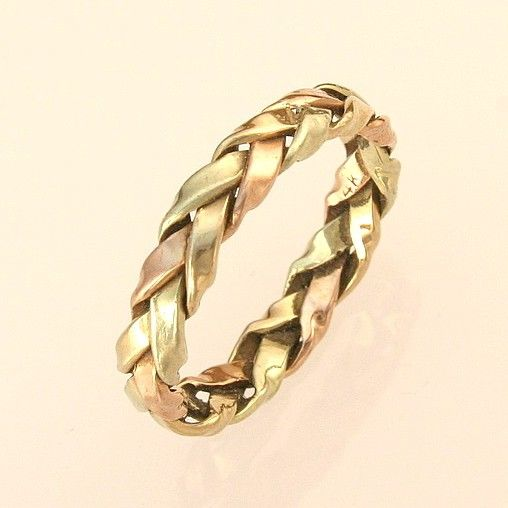 Braided Wedding Ring, in multiple gold strands, for the bride. $420.00, via Etsy. Love this