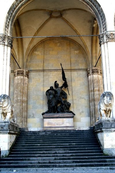 """The Feldherrnhalle (""""Field Marshals' Hall"""") is a monumental loggia with two big lion statues on the right and left side of the steps which is located at ...."""