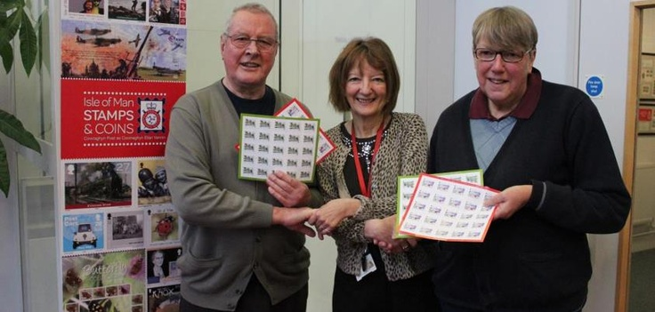 """Our first week winners of our Post Shop Christmas Comp Christine and David Tomlinson, of Douglas.  Presented with their £50 worth of postage by Dot Tilbury, General Manager, Isle of Man Stamps & Coins at IOM Stamps & Coins.David Tomlinson said: """"It was a very pleasant surprise to be told we had won live on Manx Radio. To win £50 worth of postage is particularly pleasing at Christmas as we do send a lot of cards, so the prize will be well used."""" Well done and congratulations Mr and Mrs…"""