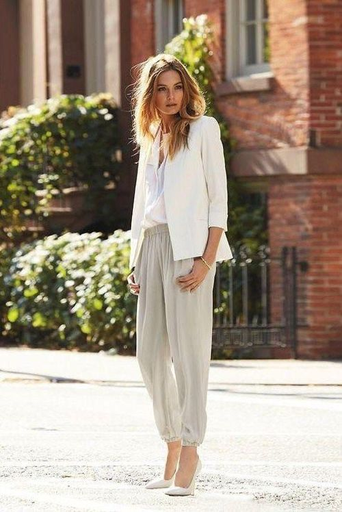 Spring trends | White blazer over shirt, grey baggy pants, matching heels